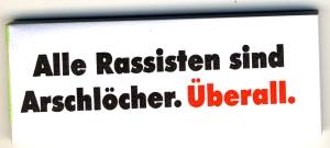Spucki / Schlecki / Papieraufkleber: Alle Rassisten sind Arschlöcher. Überall.