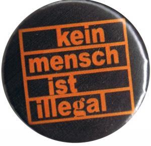 50mm Button: Kein Mensch ist illegal (orange/schwarz)
