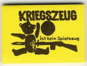 Spucki / Schlecki / Papieraufkleber: Kriegszeug ist kein Spielzeug