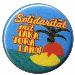50mm Button: Solidarität mit Taka Tuka Land