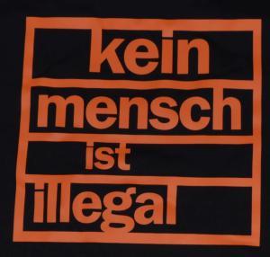 Detailansicht Fairtrade T-Shirt: Kein Mensch ist illegal (orange)
