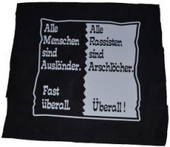 """Zum Rückenaufnäher """"Alle Menschen sind Ausländer. Fast überall. Alle Rassisten sind Arschlöcher. Überall!"""" für 2,92 € gehen."""