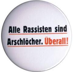 """Zum 50mm Magnet-Button """"Alle Rassisten sind Arschlöcher. Überall."""" für 2,92 € gehen."""