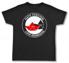 """Zum Fairtrade T-Shirt """"Hate Fascism - Love Seebrücke"""" für 17,00 € gehen."""
