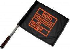"""Zum/zur  Fahne / Flagge (ca 40x35cm) """"Kein Mensch ist illegal (orange)"""" für 11,00 € gehen."""