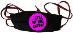 """Zur Mundmaske """"... still loving antifa! (pink)"""" für 6,34 € gehen."""