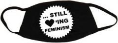 """Zur Mundmaske """"... still loving feminism"""" für 6,50 € gehen."""