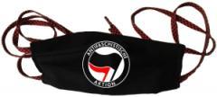 """Zur Mundmaske """"Antifaschistische Aktion (schwarz/rot)"""" für 6,34 € gehen."""