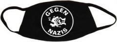 """Zur Mundmaske """"Gegen Nazis (rund)"""" für 6,50 € gehen."""