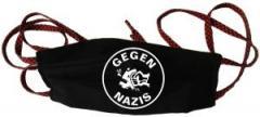 """Zur Mundmaske """"Gegen Nazis (rund)"""" für 6,34 € gehen."""
