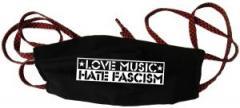 """Zur Mundmaske """"Love Music Hate Fascism"""" für 6,50 € gehen."""