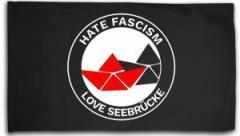 """Zur Fahne / Flagge (ca. 150x100cm) """"Hate Fascism - Love Seebrücke"""" für 16,00 € gehen."""