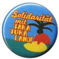 """Zum 50mm Button """"Solidarität mit Taka Tuka Land"""" für 1,20 € gehen."""