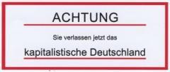 """Zum Aufkleber """"Achtung sie verlassen jetzt das kapitalistische Deutschland"""" für 1,00 € gehen."""