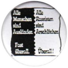 """Zum 25mm Button """"Alle Menschen sind Ausländer. Fast überall. - Alle Rassisten sind Arschlöcher. Überall!"""" für 0,80 € gehen."""