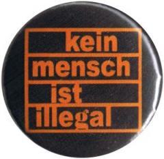 """Zum 25mm Button """"Kein Mensch ist illegal (orange/schwarz)"""" für 0,78 € gehen."""