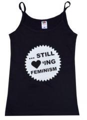 """Zum Top / Trägershirt """"... still loving feminism"""" für 14,50 € gehen."""