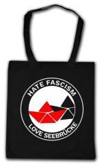 """Zur Baumwoll-Tragetasche """"Hate Fascism - Love Seebrücke"""" für 4,00 € gehen."""
